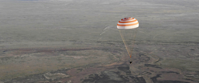 Expedition 51 crew descends to a parachuted landing.